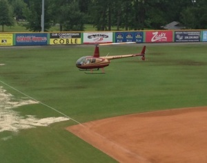 The Burlington Royals brought in a helicopter to try to dry the rain-drenched field on Friday.